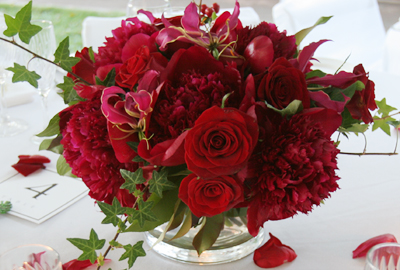 deeo red roses with gloriosa lilies and red peonies