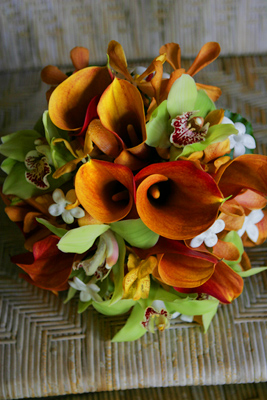 orange min calla lilies with green orchids for bride