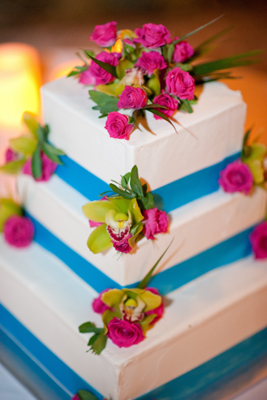 wedding cake with aqau ribbon and pink roses