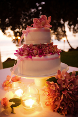 wedding cake with pink orchid center