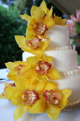 wedding cake with yellow orchids