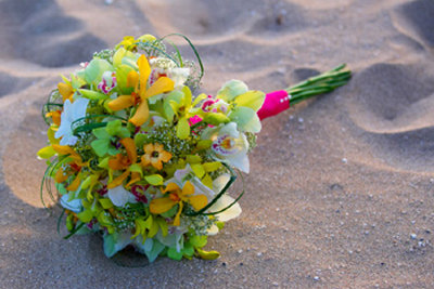 yellow orchid bouquet wwwith hot pin k ribbon