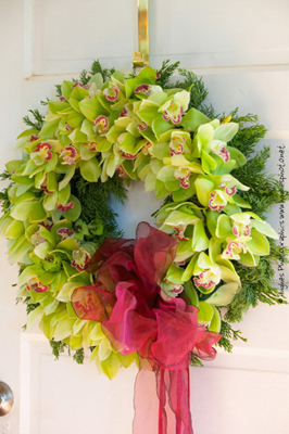 green cymbidium orchid wreath with hot pink bow