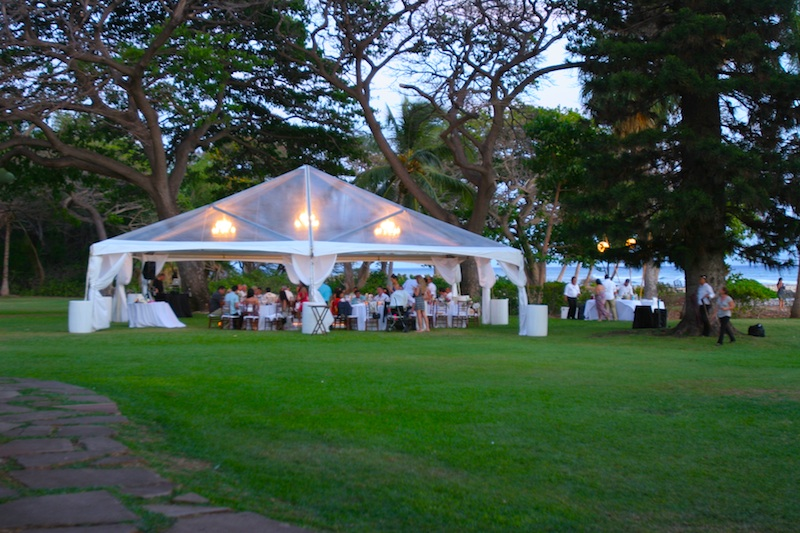 Beatiful lighting in clear top tent for wedding